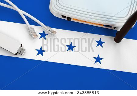 Honduras Flag Depicted On Table With Internet Rj45 Cable, Wireless Usb Wifi Adapter And Router. Inte