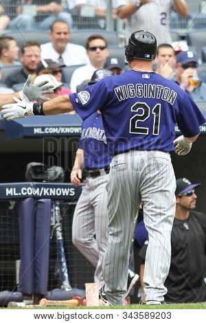 BRONX, NY - JUN 26: Coorado Rockies third baseman Ty Wigginton (21) is congratulated by teammates after hitting a solo homerun against the New York Yankees on June 26, 2011 at Yankee stadium.