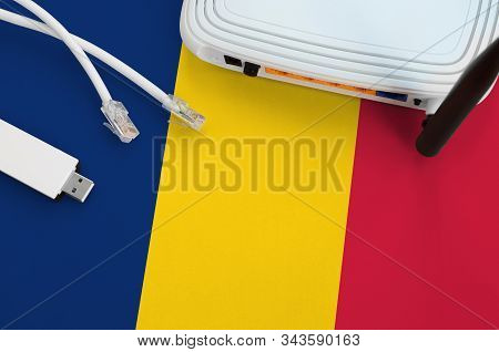 Chad Flag Depicted On Table With Internet Rj45 Cable, Wireless Usb Wifi Adapter And Router. Internet