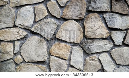 The Texture Of The Stone Wall. Old Castle Stone Wall Texture Background. Stone Wall As A Background