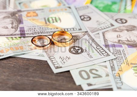 An Old, Crumpled Dollar And A Small Childrens Toy. Alimony, Childrens Pocket Money. The Background I