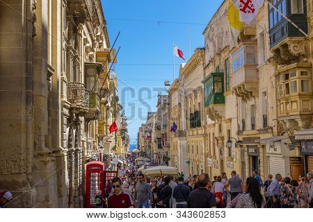 Valletta, Malta - May 1, 2019: Typical Narrow Maltese Streets With Colorful Traditional Windows And