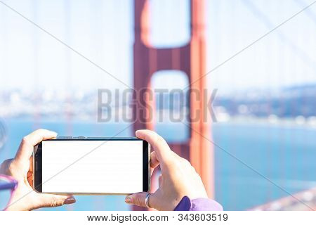 Female Hands Taking Photo On Smart Phone In Front Of Golden Gate, Sf. Mockup.