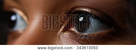 Letterbox View Of Black Woman Wide Opened Left Eye Close-up