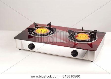 Kitchen Gas Stove With Burning Burners Isolated On White Background