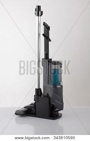 Modern Vacuum Cleaner In Keeping Stand Isolated On White Background