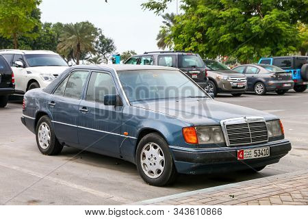 Abu Dhabi, Uae - November 17, 2018: Old Sedan Car Mercedes-benz E-class (w124) In The City Street.