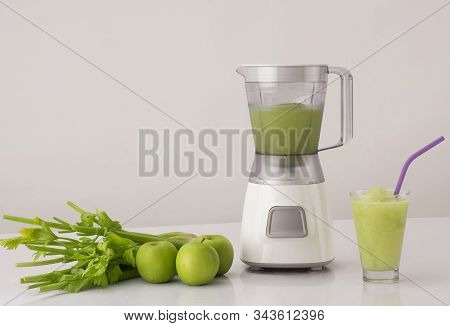 Blender With Celery And Apples On The Kitchen Table, Healthy Eating Concept