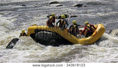 Accident In Rafting. People In A Dangerous Situation Are Waiting For Help. White Water Rafting In Vi