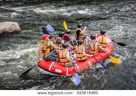 Victoria Falls / Zambia - July 22 2019: Group Of Men And Women, Enjoy Water Rafting Activity At Rive