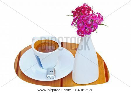 Cup With Coffee And Bouquet Of Pink On The Table
