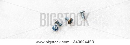 Five M3 Size Bolts With A Phillips Screwdriver Head On A White Background