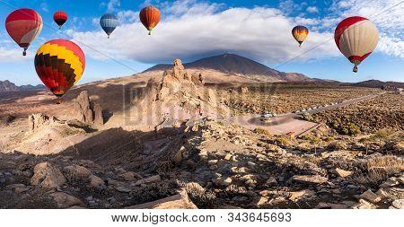 Landscape With Hot Air Balloons Flying In Teide National Park, Tenerife, Canary Islands, Spain. In B