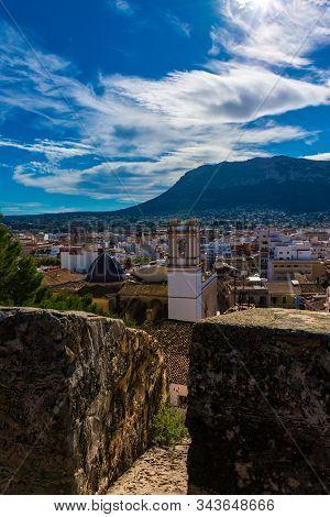 Denia, Alicante, Spain, November 21, 2018: Battlement Wall, Overlooking The Village, Montgo Mountain