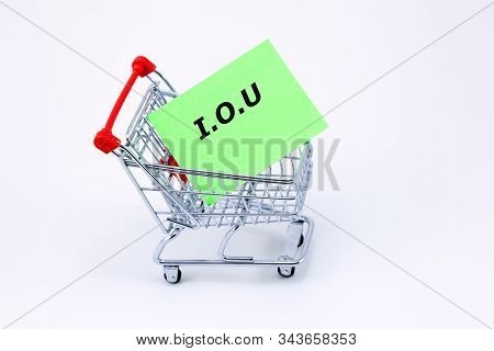 Money Lending Concept - Shopping Trolley Carrying An Iou Note