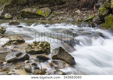 Fast Mountain River Flows In Deep Forest Among Rocks And Mossy Stones. River Stiavnica. Janska Valle