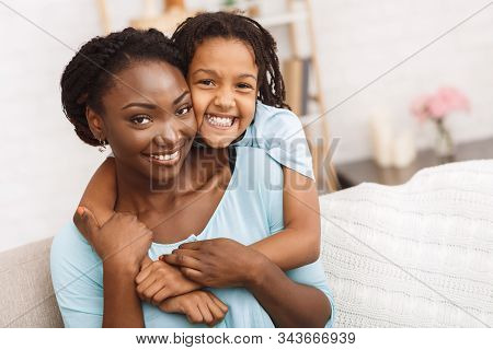 Family Bonding. Happy Black Mother And Daughter Hugging, Spending Time Together, Looking At Camera,
