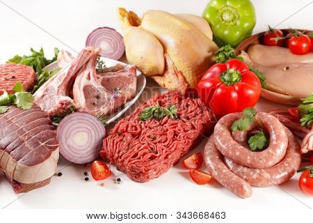 assorted of raw meats on white background- roast beef, sausage, minced beef, chicken, lamb chop
