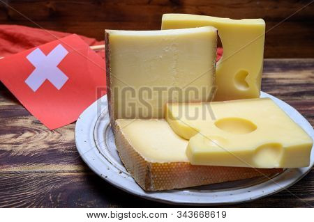 Cheese Collection, Swiss Emmentaler, Gruyere, Appenzeller Cheeses And Flag Of Switzerland
