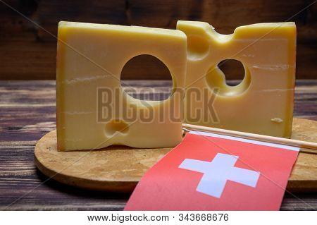 Cheese Collection, Swiss Emmentaler Cheese With Big Holes And Flag Of Switzerland