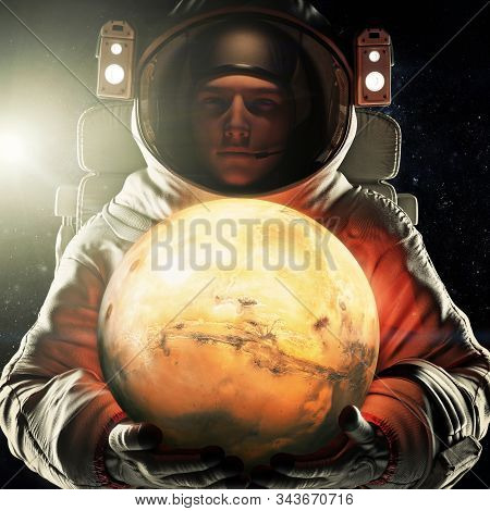 Astronaut Holding The Red Planet Of Mars. Exploration And Journey To Mars Concept. 3d Rendering .ele