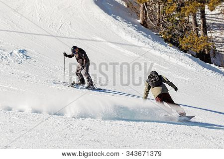 Pyrenees, Andorra - February 17, 2019: A Snowboarder Descends From The Mountain At High Speed At A S