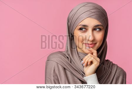 Closeup Portrait Of Beautiful Smiling Muslim Woman In Hijab Smirking, Thinking About Something And L