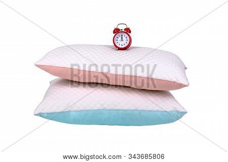 Two Modern Pillows And Red Alarm Clock Isolated On White Background, Sleeping Time Concept