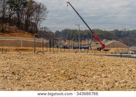Daejeonn, South Korea; December 25, 2019: Unidentified Man Standing On Flatbed Of Truck Using Crane