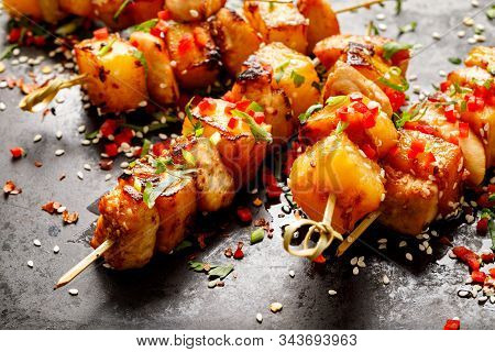 Grilled Skewers With Pineapple Fruit And Chicken Meat  Sprinkled With Sesame Seeds, Chilli Pepper, F