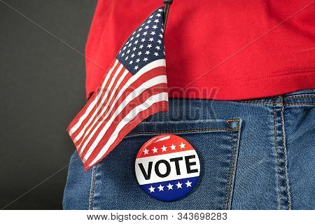 Election Vote Pin On Blue Jean Pocket With American Flag And Red Shirt