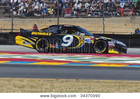 SONOMA, CA - JUN 24, 2012:  Marcos Ambrose (9) brings his car through the turns during the Toyota Save Mart 350 at the Raceway at Sonoma in Sonoma, CA on June 24, 2012.