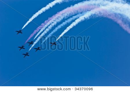 SONOMA, CA - JUN 24, 2012:  The nation's only civilian aerobatic jet team, The Patriots Jet Team, perform before the Toyota Save Mart 350 at the Raceway at Sonoma in Sonoma, CA on June 24, 2012.