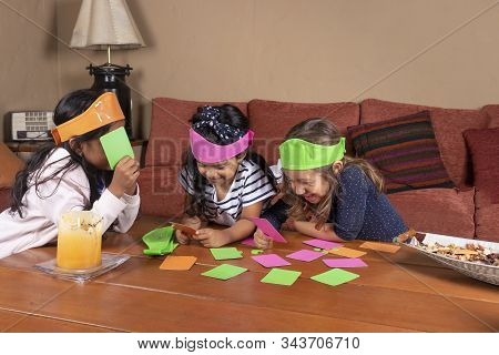 Little Girls Playing Board Games With Colored Chips