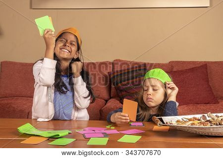Girl Celebrates After Winning Her Card Game