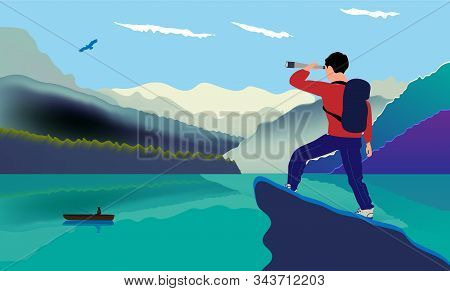 A Man With A Backpack, Traveler Or Explorer Standing On Top Of A Mountain Or Cliff And Looking At A
