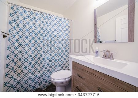Small Bathroom With Patterned Shower Curtain In House
