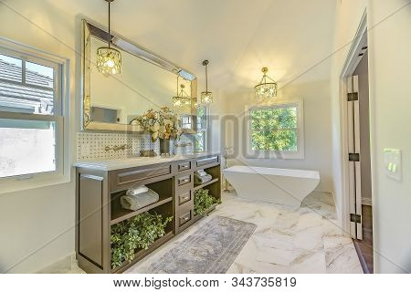 Bathroom Interior With Marble Flooring And Bathtub Adjacent To The Vanity Area