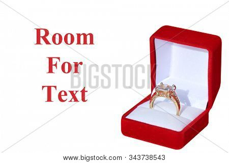 Engagement Ring. Wedding Ring. Gold and Diamond Engagement or Wedding Ring in a Red Velvet Ring Box. Isolated on white. Room for text. clipping path. Wedding Rings are enjoyed world wide by people.