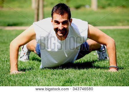 Man Doing Push-ups At The City Park