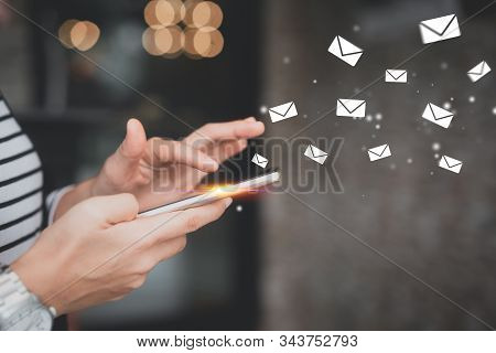 Woman Hand Using Smart Phone At Coffee Shop With Email Icon Flying Abstract. Technology Business And