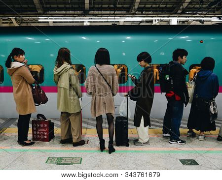 Tokyo, Japan - Nov 3, 2019. Passengers Waiting For Shinkansen Train At Jr Station In Tokyo, Japan. H