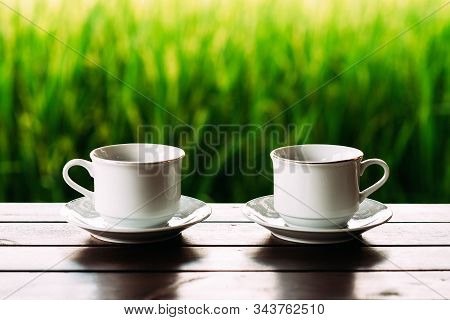 White Tea Cups On A Beautiful Background. White Coffee Cups Against The Background Of Rice Terraces