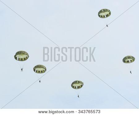 Paratroopers Parachuting For Display At Iruma Air Base (rjtj) In Saitama, North Of Tokyo, Japan.