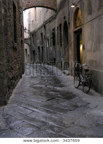 Typical narrow street in Europe with bycicle