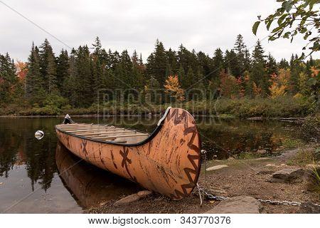 Canadian Rabaska Canoe On The Wapizagonke Lake. Mauricie National Park. Quebec. Canada