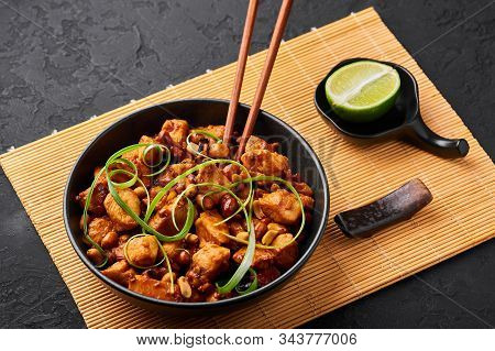 Kung Pao Chicken Or Gong Bao Ji Ding At Dark Slate Background. Sichuan Kung Pao Is Chinese Cuisine D
