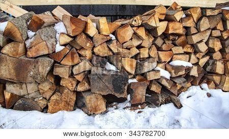 Woodpile Of Firewood In The Snow Closeup. Georgia