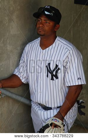 BRONX, NY - JUN 26: New York Yankees outfielder Homer Bush waits in the dugout during the Yankees Old Timer's Day pregame ceremonies on June 26, 2011 at Yankee Stadium.