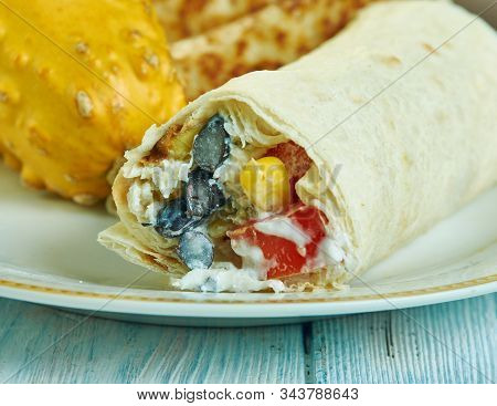 Southwest Chicken Hummus Wrap , Southwest  Cuisine, Traditional Assorted American Dishes, Top View.